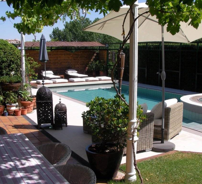 Piscina con spa integrado