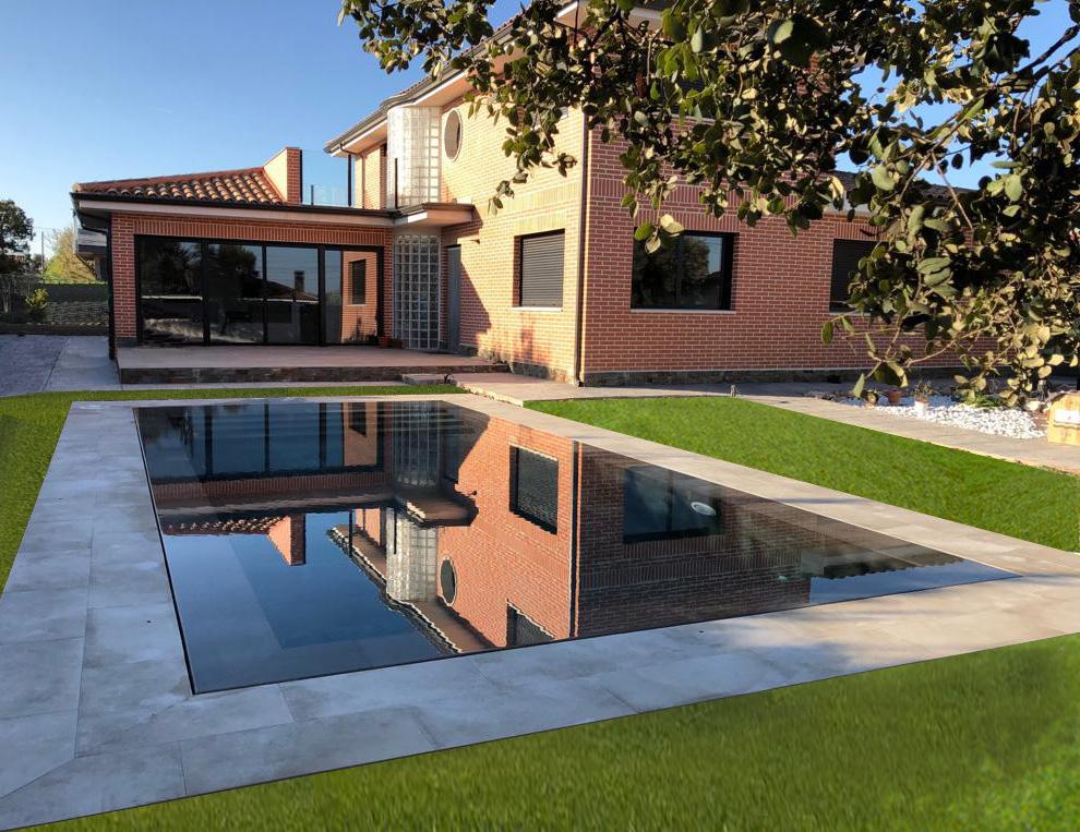 Construcción de piscina desbordante con rejilla invisible